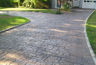 Weathered looking stamped concrete driveway.