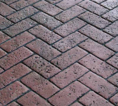 Red brick stamp in a zigzag shape.