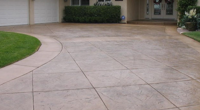 Stamped concrete driveway, and front porch.