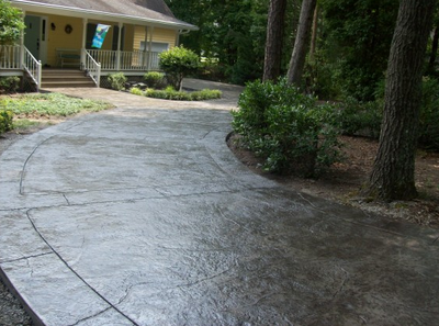 Stamped concrete driveway in the woods of Norwalk.